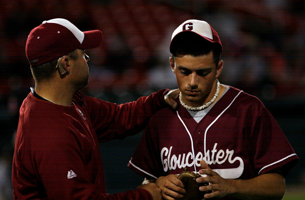 Brockton: Chris DeWolfe consoles Gloucester pitcher Taylor Burbine as he leaves the field in the 6th inning of their 8-3 loss to BC High in the State Semi-Finals at Campanelli Stadium in Brockton last night. Photo by Kate Glass/Gloucester Daily Times Wednesday, June 10, 2009