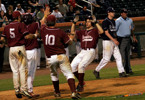 Lowell: Gloucester's Taylor Burbine scores in the eighth inning against St. John's Prep in the Division I North Championship at LeLacheur Park in Lowell on Saturday night. Photo by Kate Glass/Gloucester Daily Times Saturday, June 6, 2009