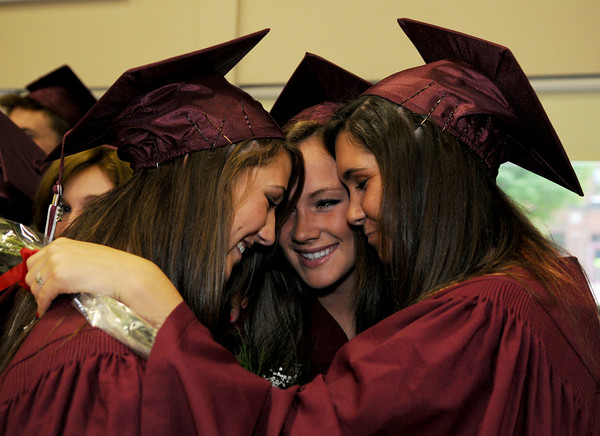 Rockport: From left, Elizabeth Fox, Sytske Roell and Olivia Sheedy hug as they prepare the head into the gymnasium for the class of 2009 graduation at Rockport High School Friday night. Desi Smith/Gloucester Daily Times
