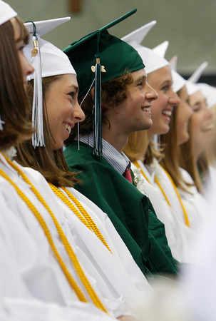 Manchester: Graham Sands-Milson, sitting next to Annelise Eaton, left, listens to class president Kevin Butler speak at the class of 2009 graduation at Manchester Essex High School Friday eveing. Mary Muckenhoutp/Gloucester Daily Times