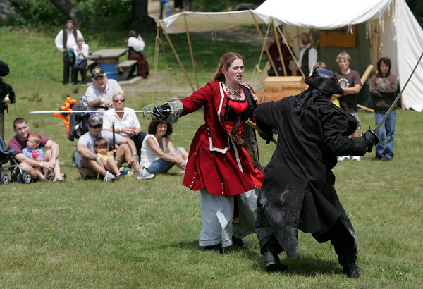 Gloucester: Members from Pastimes Entertainment partake in a pirate fight at the annual New England Pirate Faire at Stage Fort Park Saturday afternoon. The festival included a variety of events including musicians, interactive plays, puppeteers, magicians and a Tortuga marketplace Mary Muckenhoupt/Gloucester Daily Times