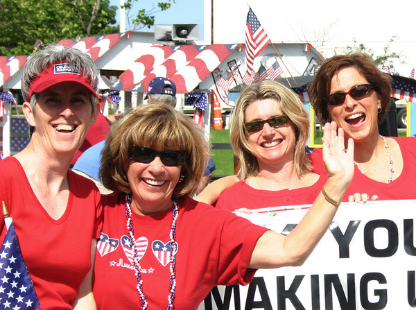 Manchester: From left, Hope Watt-Bucci, Patti Cohen, Gretchen Parker and Mary Ellen Feener from Coldwell Banker gear up for the Manchester 4th of July Parade Saturday morning. Silvie Lockerova/Gloucester Daily Times