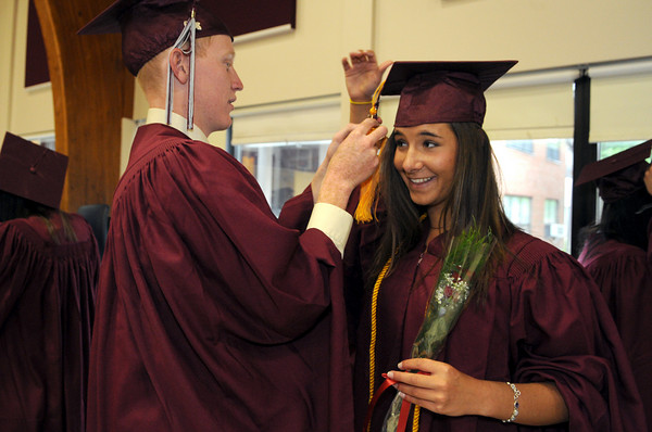 Rockport: Bryan Taylor fixes the cap of Jessica Dunn as the class of 2009 gets ready for graduation at Rockport High School Friday night. Desi Smith/Gloucester Daily Times