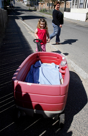 Gloucester: Lilly Interrante, 2, pulls her wagon as she goes for a walk with her grandmother, Janet Sinagra, yesterday afternoon. Photo by Kate Glass/ Gloucester Daily Times Tuesday, June 16, 2009