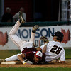 Brockton: Glucester's Frank Taormina gets upended as he tags BC High's Billy Kiley out at third base during the State Semi-Finals at Campanelli Stadium in Brockton last night. Photo by Kate Glass/Gloucester Daily Times Wednesday, June 10, 2009