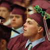 Gloucester: Trevor Curley waits and watches as fellow classmates receive their diploma at the Benjamin Smith Feild House Sunday afternoon.  Desi Smith Photo/ Gloucester Daily Times.June 14,2009