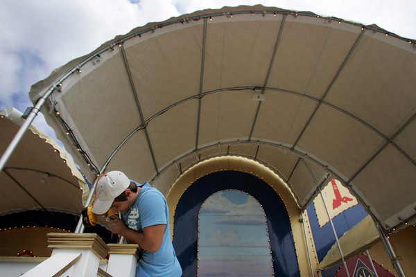 Gloucester: With St. Peter's Fiesta just days away Giacomo Romeo works on the finishing touhes of the alter Saturday afternoon. Mary Muckenhoupt/Gloucester Daily Times