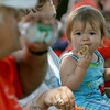 Gloucester:  Candace Kastanopolous, 15 months, enjoys a hamburger at the Summer Lunch Kick-Off Picnic at Riverdale Park Thursday afternoon.  Summer Lunch is a 10-week program offering free lunch for kids age one to 18 in six locations on Cape Ann including Willowood Gardens, Cape Ann YMCA, Veterans Memorial School, Open Door Dining Room, Kitefield Road. Program is a partnership between The Open Door, Gloucester and Rockport Housing Authorities, Gloucester School Food Service and the Cape Ann YMCA.  Mary Muckenhoupt/Gloucester Daily Times