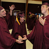 Rockport: From left, Toiva Wiberg, Sarina Barbara and James Beaton get psyched up for graduation with the class of 2009 at Rockport High School Friday night. Desi Smith/Gloucester Daily Times