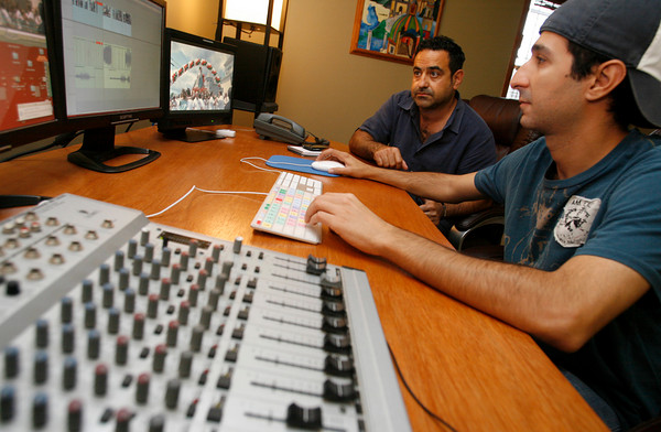 Gloucester: Gianni Gallo of Gallo Productions watches as Anthony Sanfilippo looks through last year's footage of St. Peter's Fiesta. The company sends coverage of Fiesta to air on Italian stations. Photo by Kate Glass/Gloucester Daily Times Monday, June 22, 2009