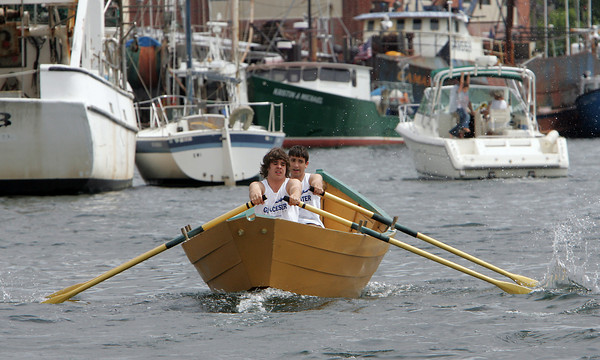 Gloucester: LJ Robertson, front, and Randy Parisi row with all their might during the International Dory Race held off the Jordrey State Fish Pier Saturday morning. Parisi and Robertson rowed in the Junior's Division race against Connoer Swim and Holden Nickerson of Canada. Photo by Mary Muckenhoupt/Gloucester Daily Times