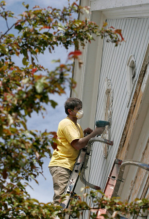 Essex: An employee of WM Corbett Arnold Building Restoration sands a window at the top of St. John's Catholic Church in Essex on Wednesday afternoon. Photo by Kate Glass/Gloucester Daily Times Wednesday, June 3, 2009