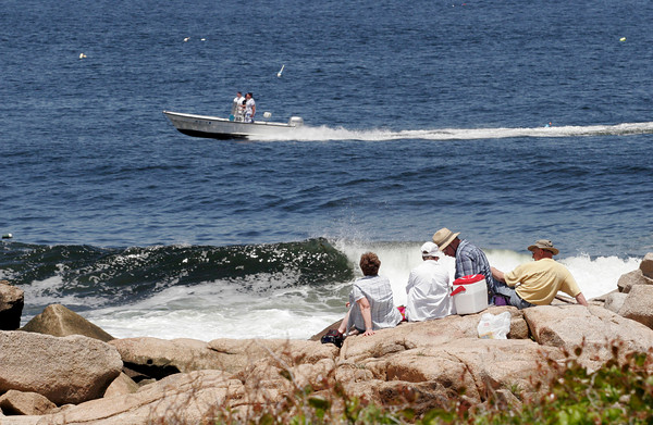 Rockport: From left: Mary Johnson, Nancy Platt, Paul Platt, and Bill Johnson picnic on the rocks at Halibut Point on Wednesday as a boat races by. Photo by Kate Glass/Gloucester Daily Times Wednesday, June 17, 2009