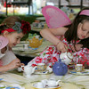 Essex: Samantha Turner, 5, left, and Tiegan Eisenhaur, 4 enjoy a cup of fairy tea at the 6th annual Fairy Festival at Underwood Photogrpahy Saturday afternoon.  The festival offered free activities for children and parents, including fairy house building, a fairy tea party, arts and crafts, and story-telling by Jape Payette. Photos were also taken of the fairies and elves with a portion of the proceeds donated to Cape Ann Habitat for Humnaity. Mary Muckenhoupt/Gloucester Daily Times