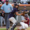 Lowell: Gloucester's Ross Carlson slides under St. John's Prep's catcher, Tyler Coppola, but is called out at home during the second inning of the Division I North Championship at LeLacheur Park in Lowell on Saturday night. Photo by Kate Glass/Gloucester Daily Times Saturday, June 6, 2009