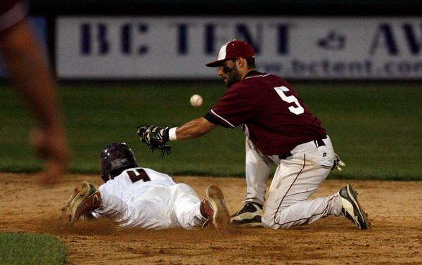 Brockton: Gloucester's Ryan Cusick misses the throw from home plate as BC High's Kyle Larrow steals second base in the State Semi-Finals at Campanelli Stadium in Brockton last night. Photo by Kate Glass/Gloucester Daily Times Wednesday, June 10, 2009