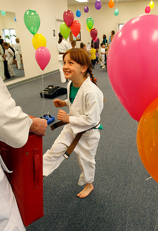 Gloucester: Maisie Grow, 7, smiles as he participates in a kick-a-thon for St. Jude Children's Research Hospital at Mahaney's Uechi Karate Academy in Gloucester on Saturday. Grow kicked for 30 minutes, took a short break, and decided she wanted to go again. Photo by Kate Glass/Gloucester Daily Times Saturday, June 6, 2009