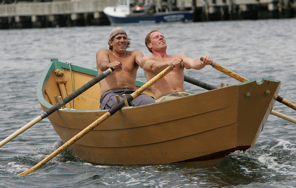Gloucester: From left, Gloucester's Jimmy Tarantino and Tom Jarvis compete in the Senior's Division of the International Dory Race held off the Jordrey State Fish Pier Saturday morning. Tarantino and Jarvis beat Canadian rowers Dan Moody and Walter Nickerson in the race. Photo by Mary Muckenhoupt/Gloucester Daily Times