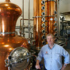 Gloucester: Bob Ryan, co-owner of Ryan & Wood Inc., Distilleries, shows thier 600 liter alembic copper pot still, which they use to make Beauport Vodka, Folly Cove Rum, and Knockabout Gin. The vodka, their first product to go to market, hits shelves on Thursday. Photo by Kate Glass/Gloucester Daily Times Tuesday, June 16, 2009