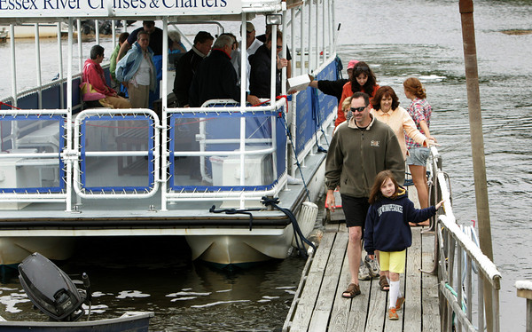 """Essex: Rhiannon Hurst and her dad Paul of Rockport are the first to get off the Essex River Cruise and Charters boat after taking a free cruise down the river with the rest of their family duirng Essex River Day Saturday.  Essex River Day was a chance for people who don't have a boat to get a free ride down the Essex River so all can enjoy the beauty of the river.  Paul said the the ride down the Essex River was awesome and very informative.""""Mary Muckenhoupt/Gloucester Daily Times"""