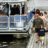 "Essex: Rhiannon Hurst and her dad Paul of Rockport are the first to get off the Essex River Cruise and Charters boat after taking a free cruise down the river with the rest of their family duirng Essex River Day Saturday.  Essex River Day was a chance for people who don't have a boat to get a free ride down the Essex River so all can enjoy the beauty of the river.  Paul said the the ride down the Essex River was awesome and very informative.""Mary Muckenhoupt/Gloucester Daily Times"