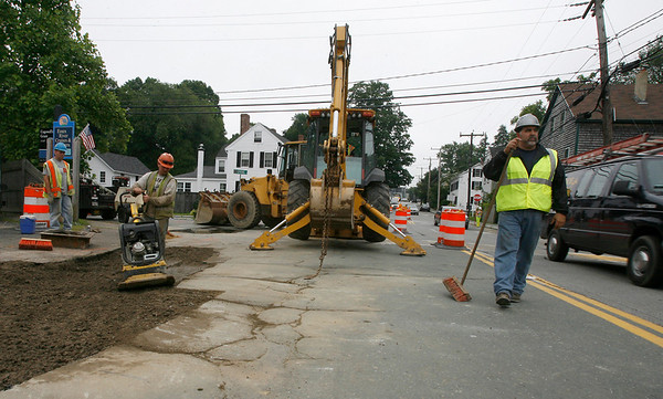 Essex: From left: Chris Geanoulis, Mike Haggerty, Paul Jones (in tractor) and John Cannatella patch up a section of road at the intersection of Route 133 and Spring Street yesterday as the first phase of construction on the road begins. Photo by Kate Glass/Gloucester Daily Times Tuesday, June 30, 2009
