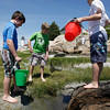Gloucester: Ben Stewart, left, Tony Milne, center, and Sam Gordon, right, create a pool for minnows they found while playing near the Annisquam Lighthouse on Wednesday afternoon. Photo by Kate Glass/Gloucester Daily Times Wednesday, June 17, 2009