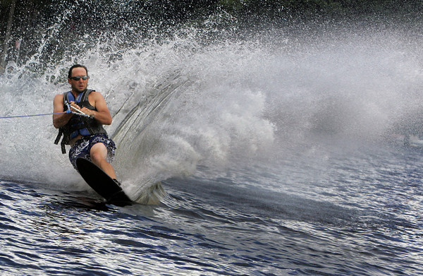 Essex: Matt Ostrowski of Essex water skis around Chebacco Lake behind his speed boat while finally enjoying a nice sunny day Saturday afternoon. Mary Muckenhoupt/Gloucester Daily Times