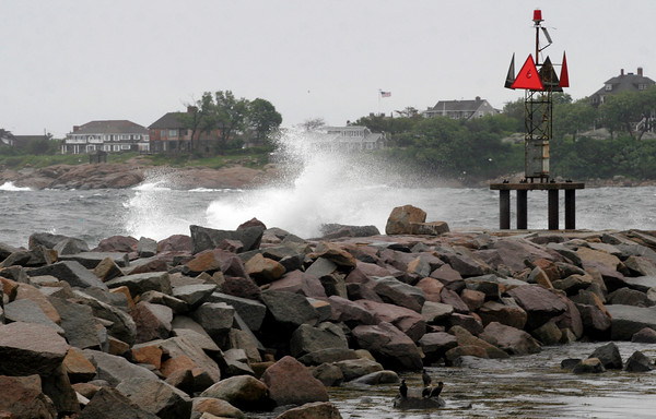 Rockport: Birds take shelter as waves crash over rocks at the end of Bearskin Neck yesterday morning. Photo by Kate Glass/Gloucester Daily Times Monday, June 22, 2009