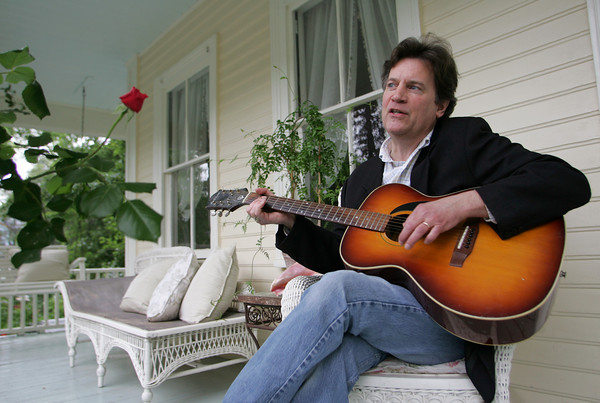 """Gloucester: Thomas Hauck sings a song on the porch of his Gloucester Home Friday afternoon.  Hauck wrote """"Pistonhead"""", a novel about a man who works on an assembly line and plays guitar in a rock band. Mary Muckenhoupt/Gloucester Daily Times"""