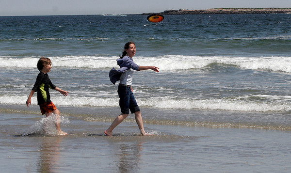 Rockport: Brendan Harlan, left, of Gloucester and Emily Millikan of Rockport toss a Frisbee at Cape Hedge Beach on Wednesday afternoon. Photo by Kate Glass/Gloucester Daily Times Wednesday, June 17, 2009