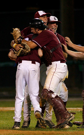 Lowell: Gloucester's Frank Taormina, Trevor Curley, and Brett Cahill mob pitcher MacKenzie Quinn after he struck out the last Lincoln Sudbury batter to cement their 2-0 win in the Division I North Semi-Finals last night. Photo by Kate Glass/Gloucester Daily Times Thursday, June 4, 2009