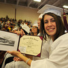Gloucester: Sara Hull shows of her diploma Sunday afternoon at the Benjamin Smith Feild House   Desi Smith Photo/ Gloucester Daily Times.June 14,2009