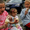 Gloucester: Lauren Alves, 6, yells as she tries to save her ice cream from falling off the cone as her siblings, Emma, 1, and Caleb, 10, watch at Friendly's on Saturday. The restaurant was giving away free ice cream cones from noon until 5. Photo by Kate Glass/Gloucester Daily Times Saturday, June 6, 2009