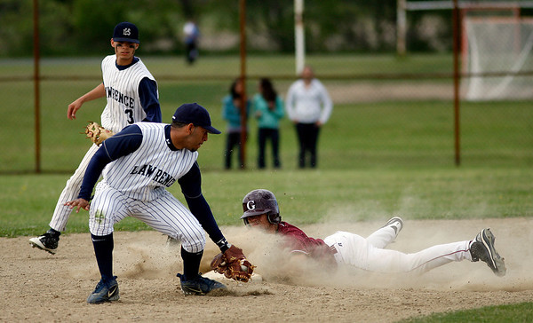 Gloucester: Lawrence's Harvey Blanco reaches to tag Gloucester's Ross Carlson at second base as Tito Luberes looks on in the second round of the North Division I tournament yesterday. Carlson was called safe. Photo by Kate Glass/Gloucester Daily Times Monday, June 1, 2009