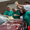 Rockport: Rockport High School freshmen Amanda Chalmers, Cameron Brousseau, Mark Foote, and Katie Reilly get covered in suds as they wash cars outside the Rockport DPW on Saturday. The car wash was a fundraiser for their class. Photo by Kate Glass/Gloucester Daily Times Saturday, June 6, 2009