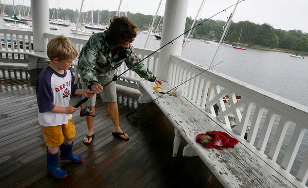 Manchester: Finn Keating, 5, goes fishing with his mother, Nicole Keating, at Tuck's Point on Tuesday afternoon. It was Finn's third time fishing. Photo by Kate Glass/Gloucester Daily Times Tuesday, June 23, 2009