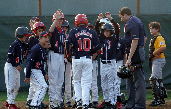 Matt Hosman's Peabody West teammates congratulate him after he hit his second home run, a grand slam, against Manchester Essex during the District 15 Little League All-Star Tournament at Stage Fort Park last night. Photo by Kate Glass/Gloucester Daily Times Monday, June 29, 2009