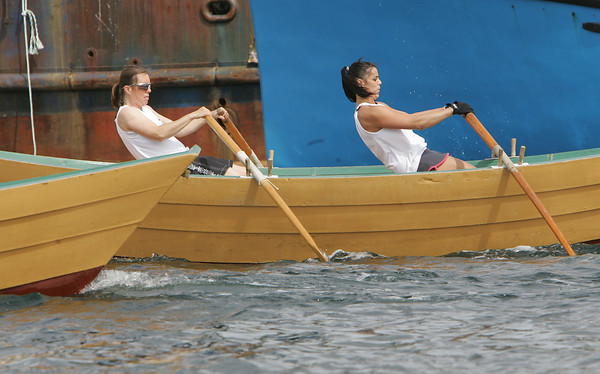 Gloucester: Katherone Richmond, left and Samantha Rose compete in the International Dory Race held off the Jordrey State Fish Pier Saturday morning. Frontero and Giacalone rowed in the Women's Division race against Natalie and Nicole Jones of Canada. Photo by Mary Muckenhoupt/Gloucester Daily Times