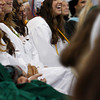 Manchester: Emily Randall laughs at a joke during the salutatorian address by Annie Osborne during gradutaion for the class of 2009 at Manchester Essex Regional High School Friday evening. Mary Muckenhoupt/Gloucester Daily Times