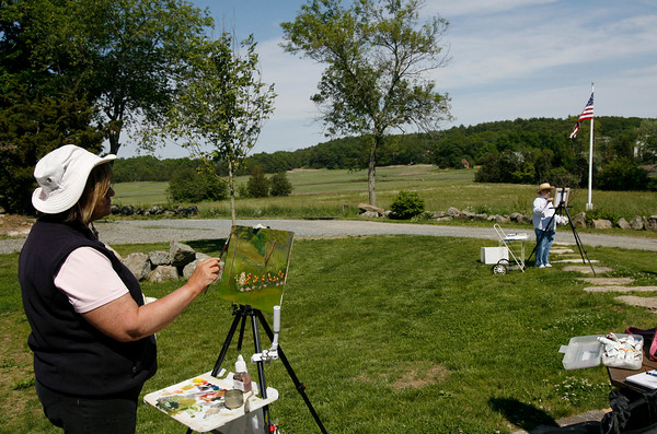 Essex: Linda Lea Bertrand, left, and Pam Russell paint landscapes at the Cox Reservation on Saturday while out with a class taught by David Curtis. Photo by Kate Glass/Gloucester Daily Times Saturday, June 6, 2009