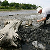 Gloucester: George Benson digs for clams along Mill River on Wednesday afternoon. He says many people do not like that area because it is too rocky. Photo by Kate Glass/Gloucester Daily Times Wednesday, June 3, 2009