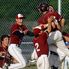 Gloucester: Trevor Curley, Frank Taormina, Ross Carlson and Conor Ressel run to congratulate Ryan Cusick after he scored on a wild pitch in the 10th inning to give Gloucester the 3-2 win over Lawrence in the second round of the North Division I tournament yesterday. Photo by Kate Glass/Gloucester Daily Times Monday, June 1, 2009