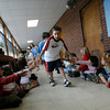 Gloucester: Matthew Sawyer high fives his classmates at West Parish Elementary School yeterday as the fifth graders take their last walk through the school. Photo by Kate Glass/Gloucester Daily Times Monday, June 22, 2009