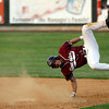 Lowell: Gloucester's Marc Alves gets upended as he crosses first base during the Division I North Championship at LeLacheur Park in Lowell on Saturday night. Photo by Kate Glass/Gloucester Daily Times Saturday, June 6, 2009