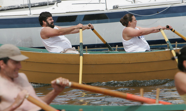 Gloucester: Len Robertson and Christna Carpenter compete in the Mixed Double's Division of the International Dory Race held off the Jordrey State Fish Pier Saturday morning. Photo by Mary Muckenhoupt/Gloucester Daily Times