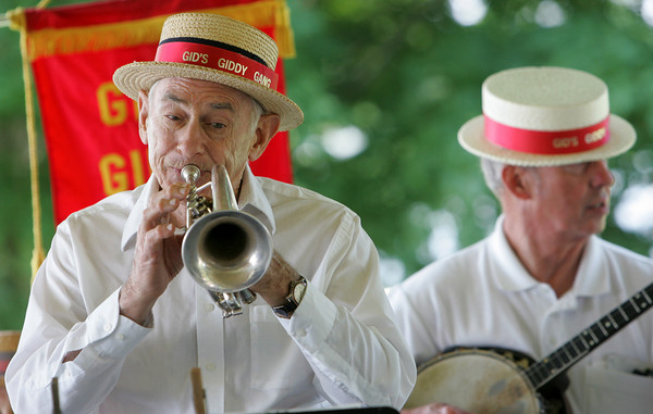 """Manchester: George """"Gid"""" Loring plays the cornet with Gid's Giddy Gang who provided Dixieland jazz for the 19th annual Red, White and Blue Breakfast put on by the Manchester Essex Rotary Club at Tuck's Point Saturday. Mary Muckenhoupt/Gloucester Daily Times"""