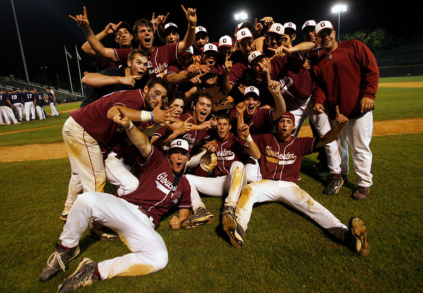 Lowell: Members of the Gloucester baseball team celebrate their 8-7 victory over St. John's Prep in the Division I North Championship at LeLacheur Park in Lowell on Saturday night. Photo by Kate Glass/Gloucester Daily Times Saturday, June 6, 2009
