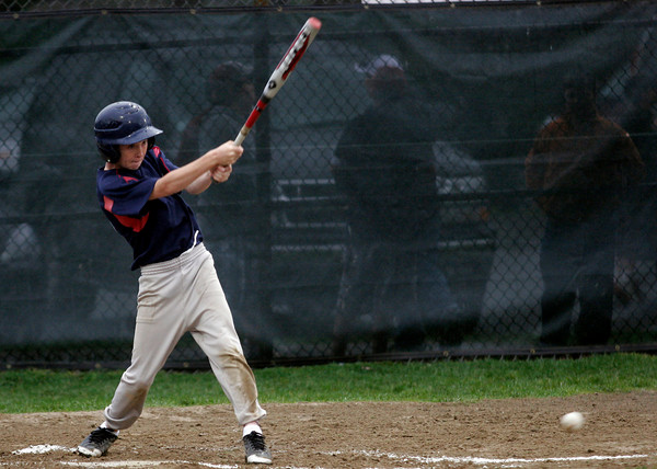Gloucester: Jared Favazza of the Indians drives in a run as they play the Pirates during the Gloucester Little League World Series at Boudreau Field last night. Photo by Kate Glass/Gloucester Daily Times Tuesday, June 23, 2009