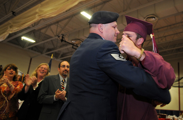 Gloucester: (Surprise Visit) Andrew Dahlmer gets a hug from his father Jon Dahlmer who flew in from Korea to surprised him just after receiving his diploma at the Benjamin Smith Feild House Sunday afternoon. Andrew hadn't seen him since St Patricks Day last year.  Desi Smith Photo/ Gloucester Daily Times.June 14,2009
